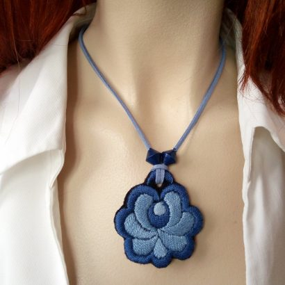 blue embroidered pendant